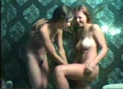 2 young teens play with each other